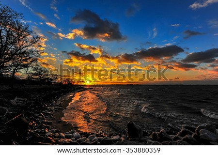Sunset on a Chesapeake Bay beach in Maryland in Winter - stock photo