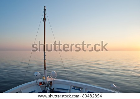 Sunset on a cruise ship on lake Onega, August 2010, Russia - stock photo