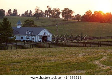 Sunset on a farm - stock photo