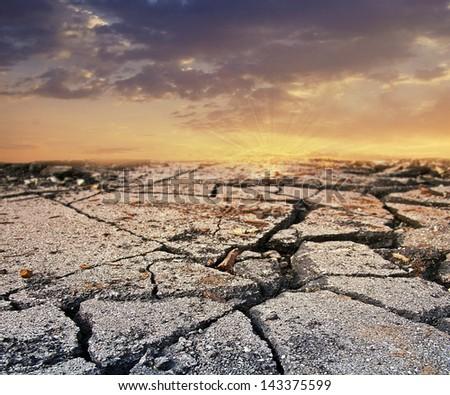sunset on a hot dry landscape - stock photo