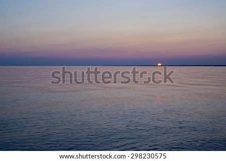 Sunset on a lake erie beach, Point Pelee conservation area, southwestern Ontario, Canada - stock photo