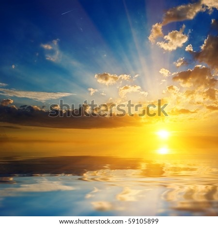sunset on a quiet lake - stock photo