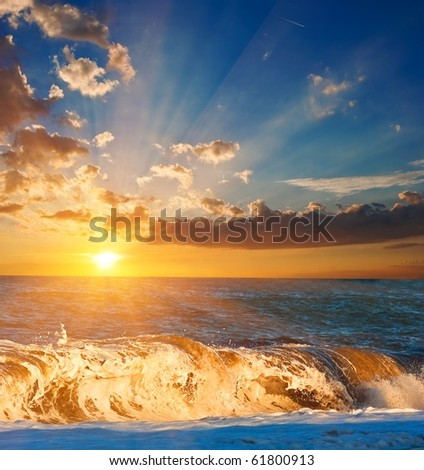 sunset on a squally sea - stock photo