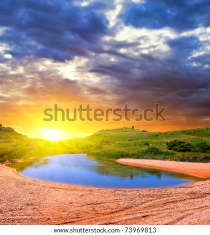 sunset on a steppe lake - stock photo