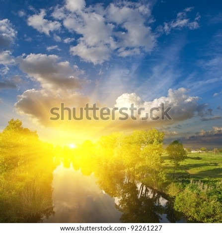 sunset on a summer river - stock photo