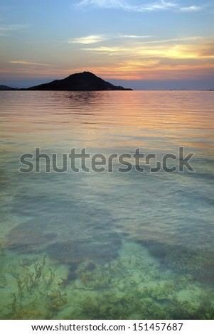 Sunset on a tropical island with a clear water in Indonesia