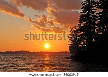 Sunset on Bayley Bay on Basswood Lake in Quetico Provincial Park - stock photo