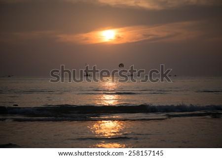 Sunset on beach in Langkawi, Malaysia - stock photo