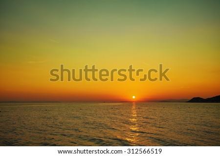 Sunset on beach / Sunset on the Adriatic. Croatia. - stock photo