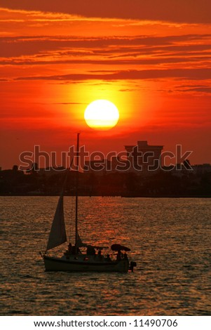 Sunset on Boca Ciega Bay with sailboat. Tampa Bay Florida - stock photo