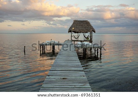 sunset on caye caulker - stock photo
