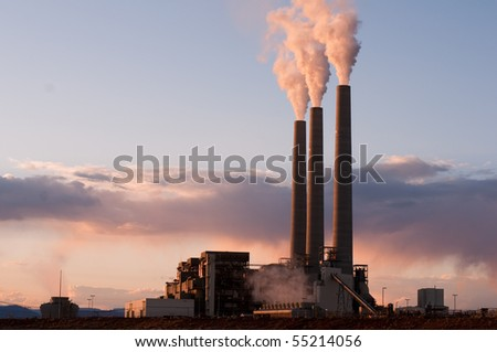 sunset on coal burning electrical plant - stock photo