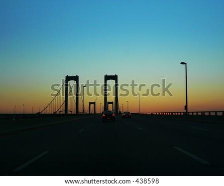 Sunset on Delaware Memorial Bridge - stock photo