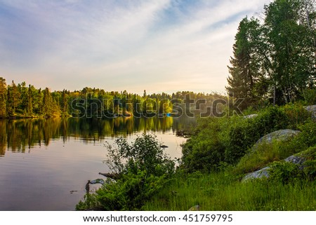 Sunset on Dogtooth Lake at Rushing River Provincial Park, Ontario, Canada - stock photo
