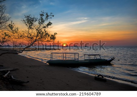 Sunset on Flores island in Komodo natrional park - stock photo