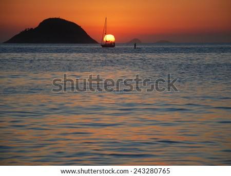 Sunset on Itaipu Beach - stock photo