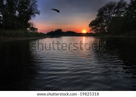 Sunset on Lake - stock photo