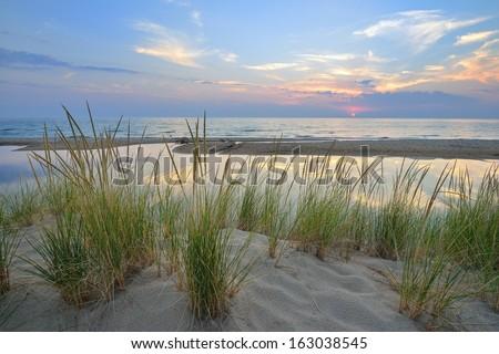Sunset on Lake Michigan sand dunes near Pentwater - stock photo
