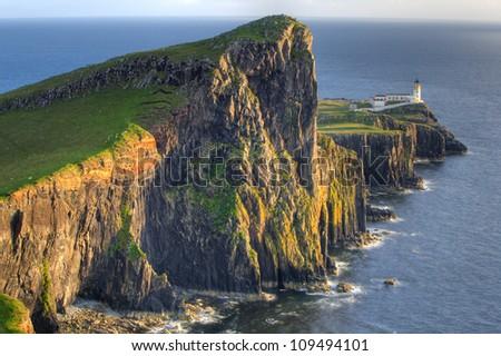 Sunset on Lighthouse at Neist Point, Isle of Skye, Scotland - stock photo