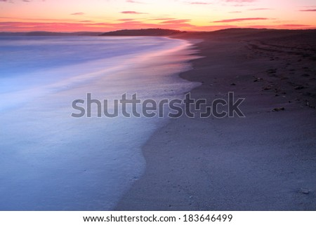 Sunset on Long strand in West Cork on the Wild Atlantic Way coastal route in Ireland Europe - stock photo