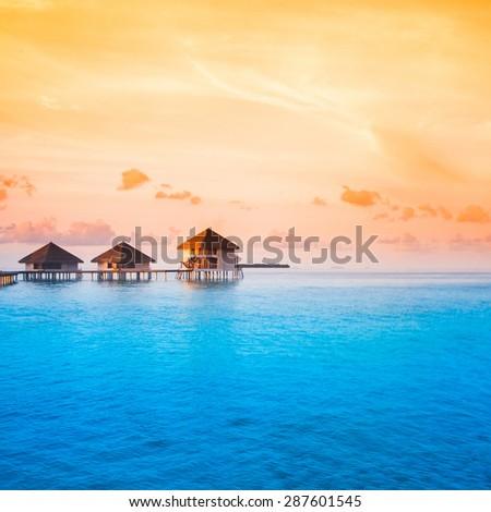 Sunset on Maldives island - stock photo