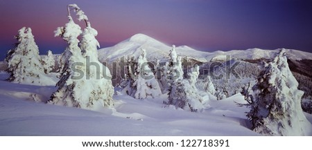Sunset on Montenegro Gentle colors of sunset rays leave the snowy ridge - stock photo