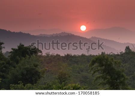 Sunset on mountain hill  in Thailand - stock photo