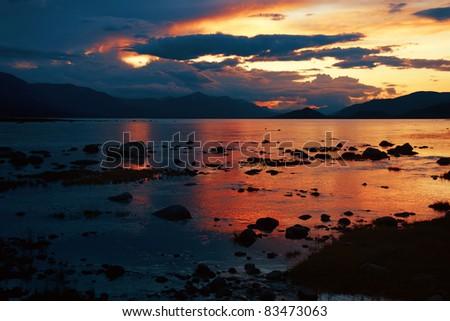 Sunset on mountain lake Hoton Nuur, Mongolia - stock photo