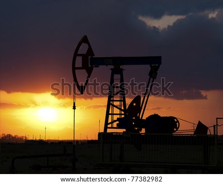 Sunset on oilfield in Asia