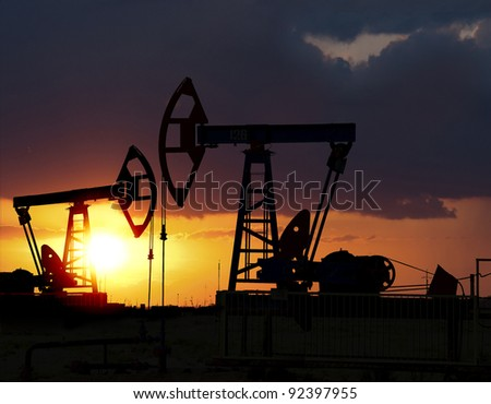 Sunset on oilfield in Asia - stock photo