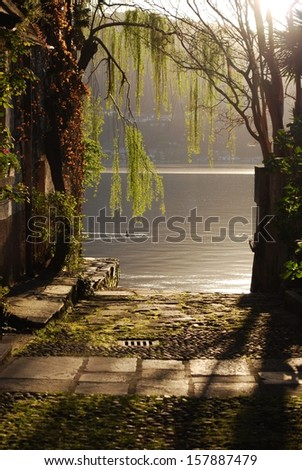 Sunset on Orta lake, Orta St. Giulio village, Piedmont, Italy - stock photo