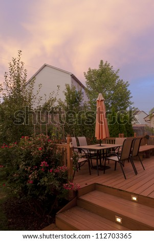 Sunset on Patio of family home in USA. Also called a Deck or Veranda. - stock photo