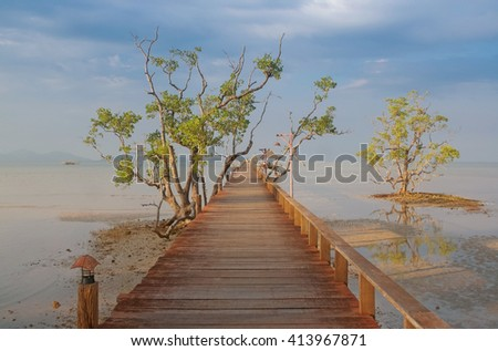 Sunset on pier at Koh Mak Island in Trat, Thailand - stock photo