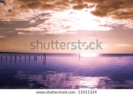 Sunset on quiet sea in Champoton, Campeche, Mexico