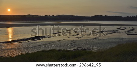 Sunset on River Severn at low tide, Purton, Gloucestershire - stock photo