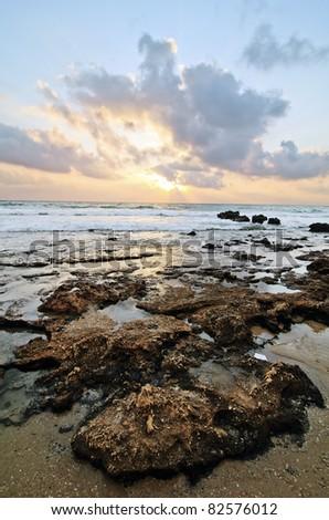 sunset on  rocky beach, Israel - stock photo