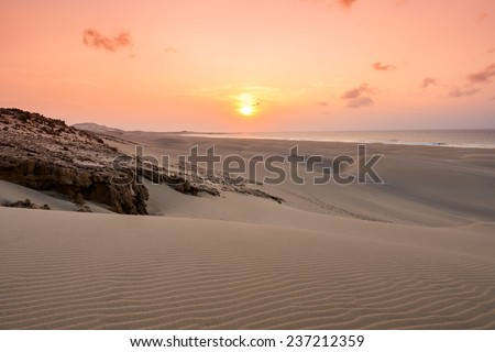 Sunset on sand dunes  in Chaves beach Praia de Chaves in Boavista Cape Verde - Cabo Verde - stock photo