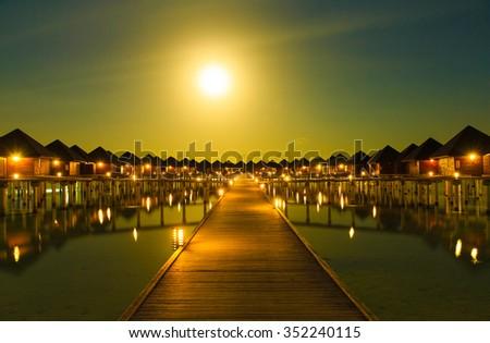 Sunset on sea in Maldives - stock photo