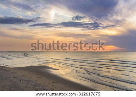 Sunset on thailand beach - stock photo