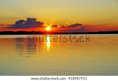 sunset on the alqueva lake  - stock photo