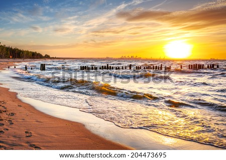 Sunset on the beach at Baltic Sea in Poland - stock photo