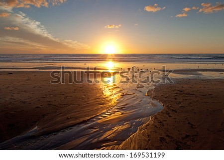 Sunset on the beach at Carlsbad, California - stock photo