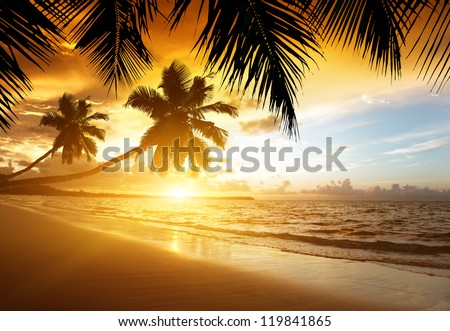 sunset on the beach of caribbean sea - stock photo