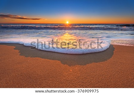 Sunset on the beach with beautiful sky. - stock photo