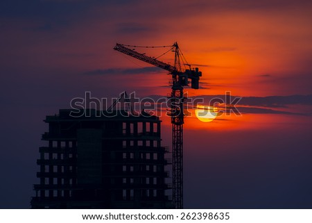 Sunset on the building under construction - stock photo