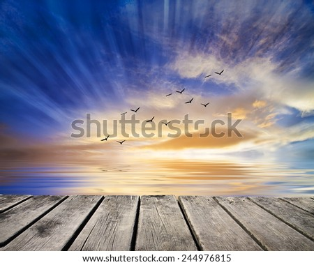 sunset on the calm sea - stock photo