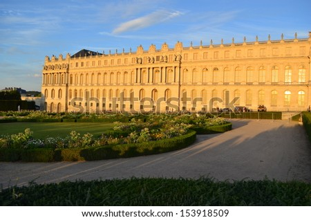 Sunset on the castle of Versailles - France - stock photo
