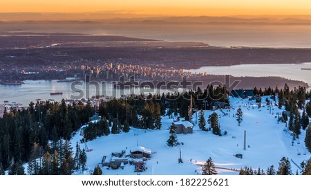 Sunset on the city of Vancouver, british Columbia, Canada, from the summit of Grouse mountain ski resort - stock photo