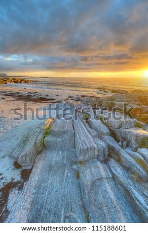 Sunset on the coast of Andoya in Norway - HDR image - stock photo