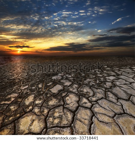 Sunset on the dried up technological waste of activity of a colliery in Ukraine - stock photo